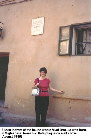 Eileen in front of the house where Vlad Dracula was born, in Sighisoara, Romania. Note plaque on wall above. (August 1985)